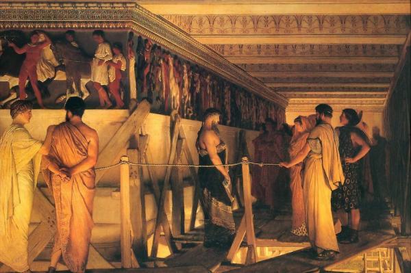 Phidias (au centre) montrant lafrise du Parthénonà ses amis, tableau deLawrence Alma-Tadema, 1868. Le nombre d'or, a été désigné par la lettreφou phi, en hommage du sculpteur grecPhidias (Ve siècle av. J.-C.). (Image : wikimedia / Lawrence Alma-Tadema / Domaine public)